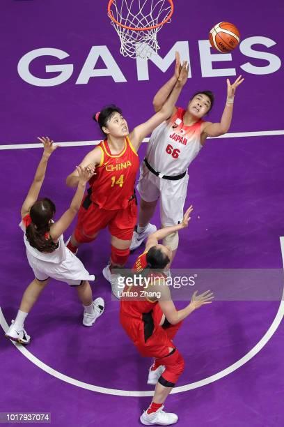 Kadysha Juna Umezawa of Japan drives to the basket against Li Yueru of China during the Basketball Women's 5x5 match between Japan and China at the...