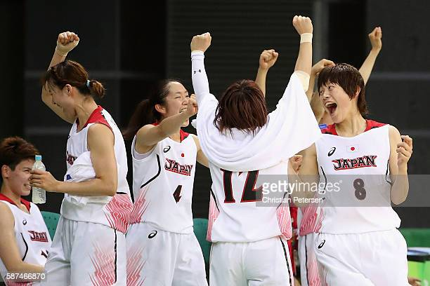 Kaede Kondo, Asami Yoshida and Maki Takada of Japan celebrate after defeating Brazil in the women's basketball game on Day 3 of the Rio 2016 Olympic...