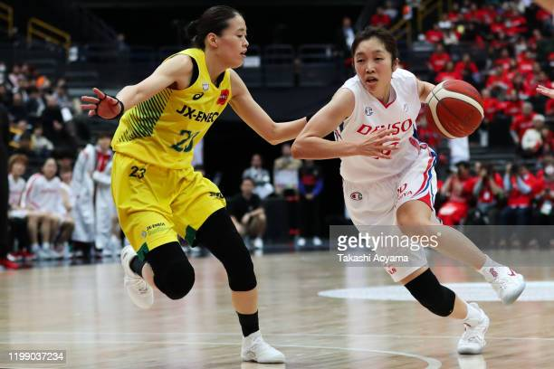 Kaede Kondo of Denso Iris drives to the basket while under pressure from Mikoto Onuma of JX-ENEOS Sunflowers during the basketball Emperss's Cup...