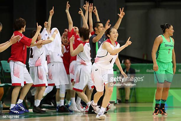 Kaede Kondo of Japan celebrates after making a three point shot against Brazil during the women's basketball game on Day 3 of the Rio 2016 Olympic...