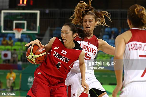 Kaede Kondo of Japan dribbles past Bahar Caglar of Turkey in the Women's Basketball Preliminary Round Group A match between Turkey and Japan on Day 4...