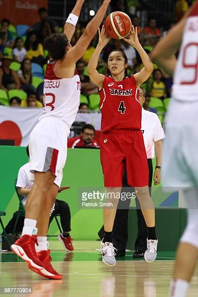 Kaede Kondo of Japan shoots in front of Sebnem Nezahat Kimyacioglu of Turkey in the Women's Basketball Preliminary Round Group A match between Turkey...