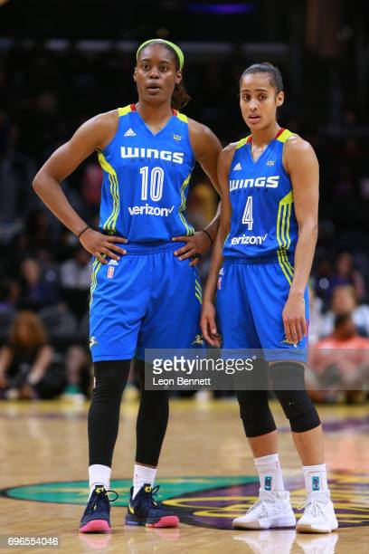 Kaela Davis and Skylar DigginsSmith of the Dallas Wings looks on during a time out against the Los Angeles Sparks during a WNBA basketball game at...