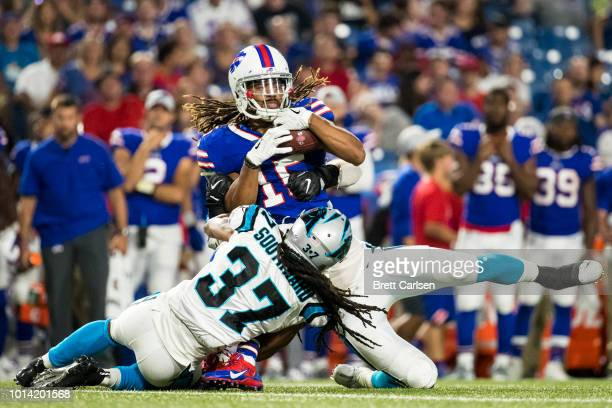 Kaelin Clay of the Buffalo Bills makes a first down reception before being brought down by Jared Norris and Dezmen Southward of the Carolina Panthers...