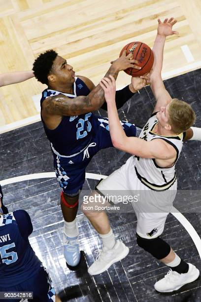 Kaelon Harris guard The Citadel Bulldogs and Trevor Stumpe guard Wofford College Terriers struggle for a rebound Saturday January 6 at Richardson...