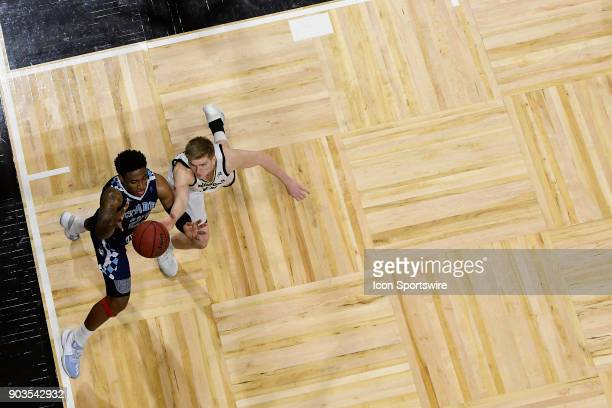 Kaelon Harris guard The Citadel Bulldogs challenges Trevor Stumpe guard Wofford College Terriers for the basketball Saturday January 6 at Richardson...