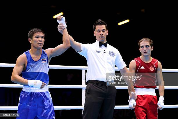 Kaeo Pongprayoon of Thailand reacts after he was declared the winner against David Ayrapetyan of Russia during their Men's Light Fly Boxing Semifinal...