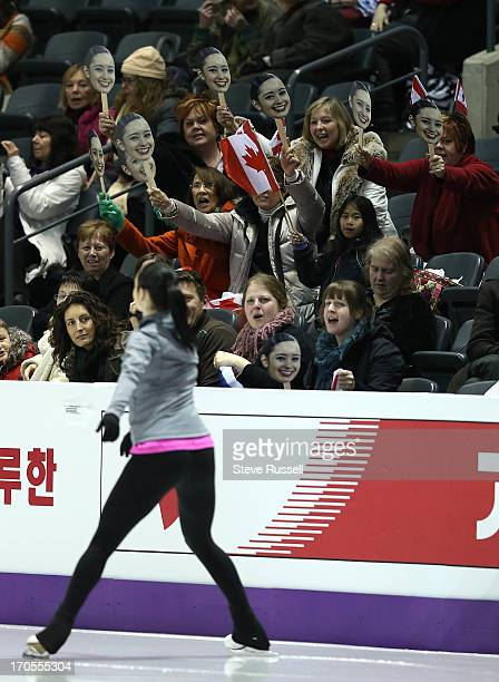 Kaetlyn Osmond fans cheer as she practices her short program as she prepares to compete in the ISU World Figure Skating Championships at Budweiser...