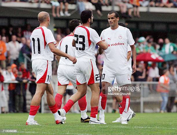 Kafes Pantelis of Olympiakos is congratulated by Rivaldo after scoring the first goal during the friendly match between Werder Bremen and Olympiakos...