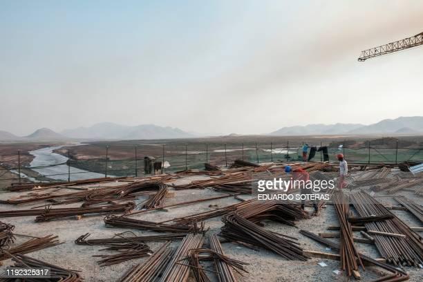 Kafule Yigzaw check iron bars at the Grand Ethiopian Renaissance Dam , near Guba in Ethiopia, on December 26, 2019. - The Grand Ethiopian Renaissance...