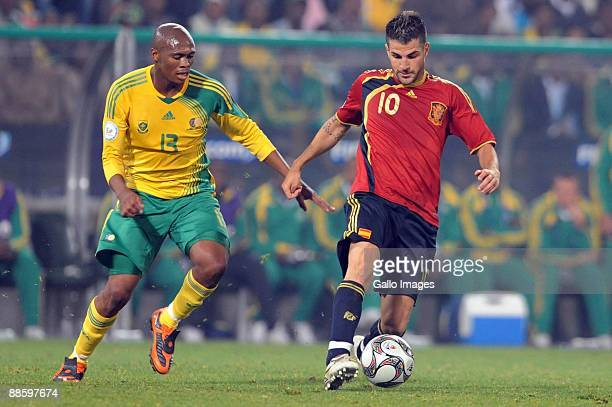 Kagisho Dikgacoi of South Africa and Cesc Fabregas of Spain in action during the FIFA Confederations Cup match between Spain and South Africa at the...