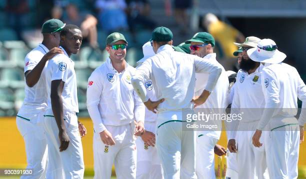 Kagiso Rabada and team mates of South Africa celebrate the wicket of David Warner of Australia during day 3 of the 2nd Sunfoil Test match between...