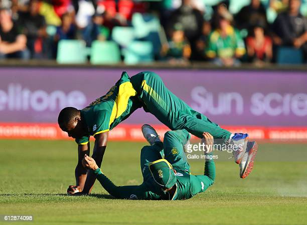 Kagiso Rabada clashes with Faf du Plessis of South Africa to take the wicket off the last ball during the 3rd Momentum ODI Series match between South...