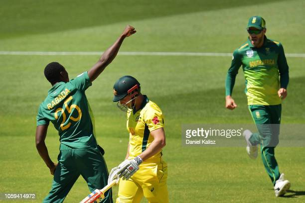 Kagiso Rabada of South Africa and Faf du Plessis of South Africa celebrate after taking the wicket of Shaun Marsh of Australia during game two of the...