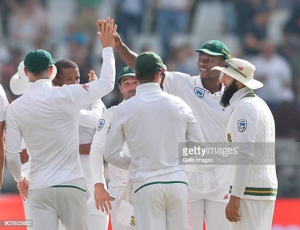 Kagiso Rabada of South Africa and team celebrate after winning the 1st Sunfoil Test match between South Africa and India at PPC Newlands on January...