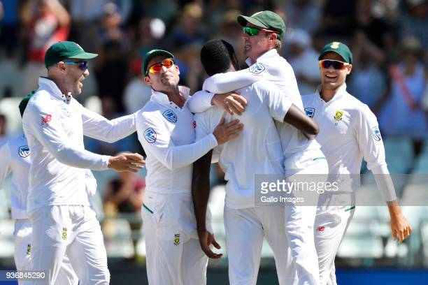 Kagiso Rabada of South Africa and team mates celebrate the wicket of David Warner of Australia during day 2 of the 3rd Sunfoil Test match between...