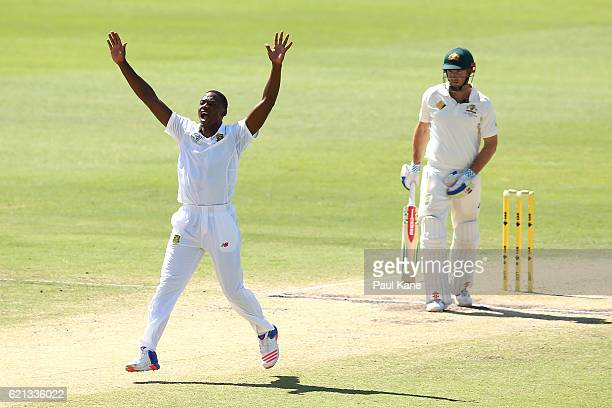 Kagiso Rabada of South Africa appeals successfully for the wicket of Shaun Marsh of Australia during day four of the First Test match between...