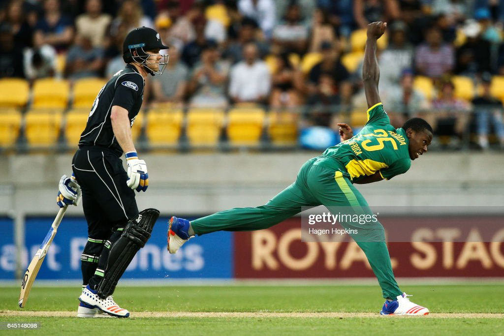 Kagiso Rabada of South Africa bowls while Jimmy Neesham of New Zealand looks on during game three of the One Day International series between New Zealand and South Africa at Westpac Stadium on February 25, 2017 in Wellington, New Zealand.
