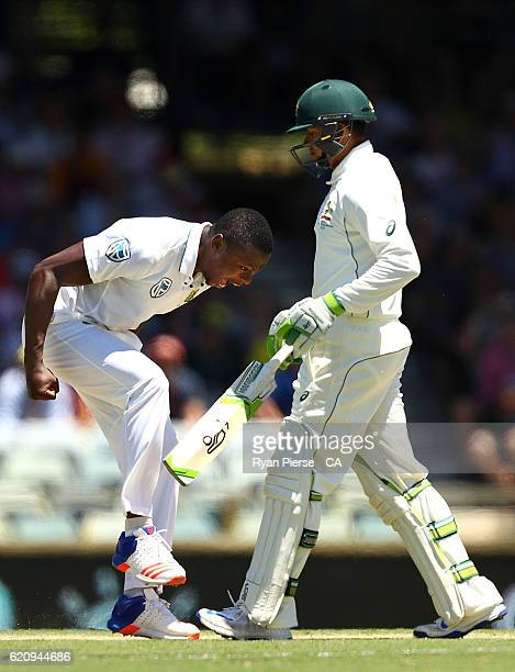 Kagiso Rabada of South Africa celebrates after taking the wicket of Usman Khawaja of Australia during day two of the First Test match between...