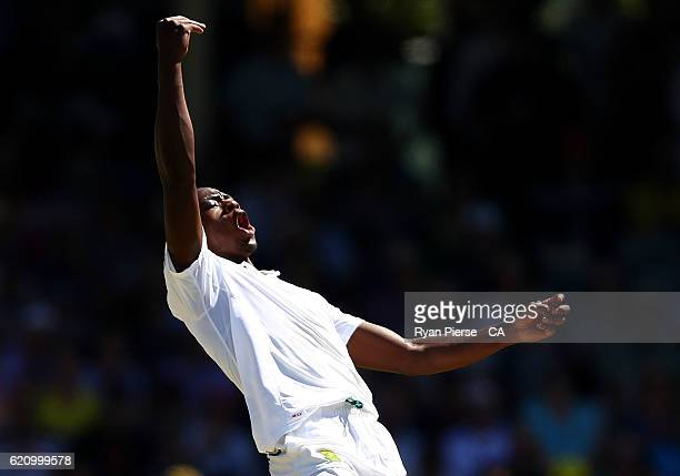 Kagiso Rabada of South Africa celebrates after taking the wicket of Adam Voges of Australia during day two of the First Test match between Australia...