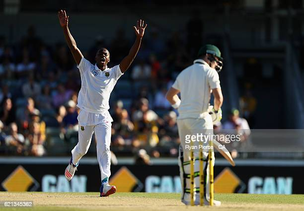 Kagiso Rabada of South Africa celebrates after taking the wicket of Steve Smith of Australia during day four of the First Test match between...