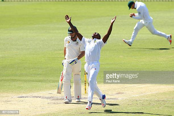 Kagiso Rabada of South Africa celebrates the wicket of Shaun Marsh of Australia during day four of the First Test match between Australia and South...