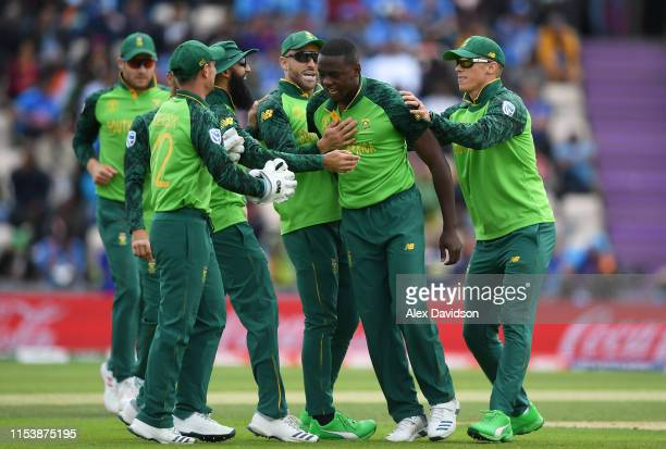 Kagiso Rabada of South Africa celebrates the wicket of Shikhar Dhawan of India with his teammates during the Group Stage match of the ICC Cricket...