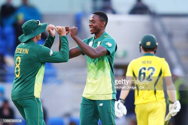 Kagiso Rabada of South Africa celebrates the wicket of Travis Head of Australia during game three of the One Day International series between...