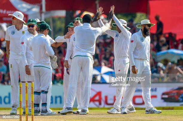Kagiso Rabada of South Africa celebrates with teammates after taking a wicket during day 2 of the 2nd Sunfoil Test match between South Africa and...