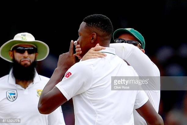 Kagiso Rabada of South Africa gestures and has his mouth covered by Dean Elgar after dismissing Ben Stokes of England on day four of the 1st Investec...
