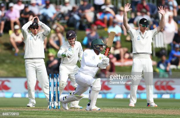 Kagiso Rabada of South Africa is bowled by Jeetan Patel of New Zealand during day two of the First Test match between New Zealand and South Africa at...
