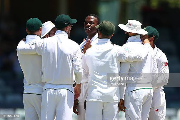 Kagiso Rabada of South Africa is congratulated by team mates after dismissing Mitchell Starc of Australia and taking his fifth wicket for the innings...