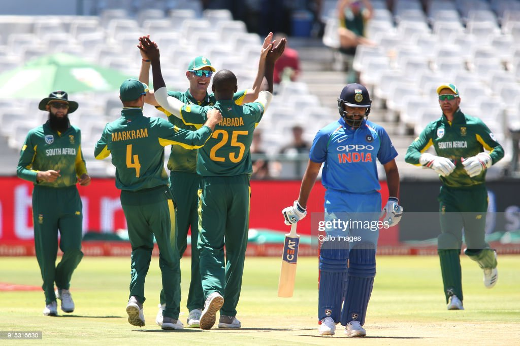 Kagiso Rabada of South Africa is congratulated Chris Morris of South Africa for getting Rohit Sharma of India's wicket during the 3rd Momentum ODI match between South Africa and India at PPC Newlands on February 07, 2018 in Cape Town, South Africa.