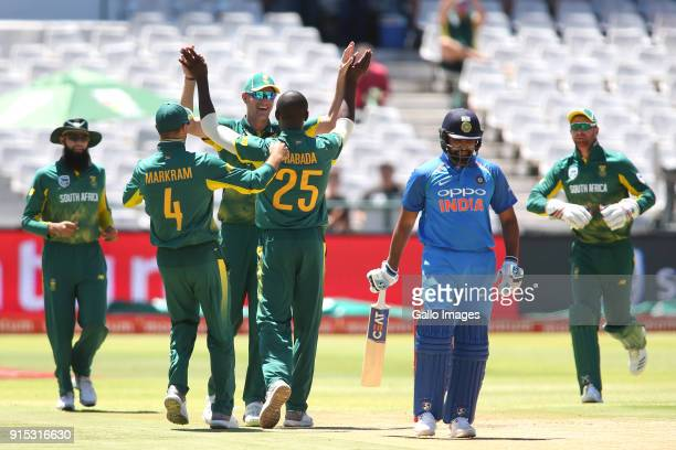 Kagiso Rabada of South Africa is congratulated Chris Morris of South Africa for getting Rohit Sharma of India's wicket during the 3rd Momentum ODI...