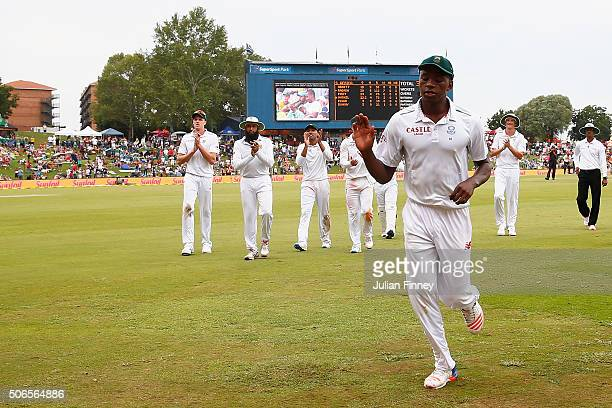 Kagiso Rabada of South Africa leaves the pitch after taking 7 wickets during day three of the 4th Test at Supersport Park on January 24, 2016 in...