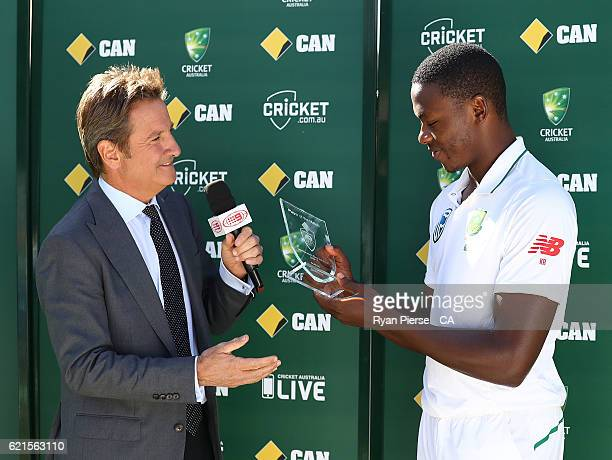 Kagiso Rabada of South Africa receives his Man of the Match trophy after day five of the First Test match between Australia and South Africa at WACA...