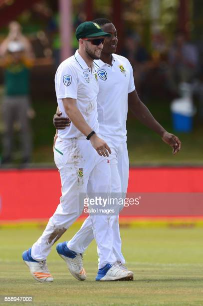 Kagiso Rabada of the Proteas celebrates his 100 test wicket of Mahmudullah of Bangladesh with Wayne Parnell of the Proteas during day 3 of the 2nd...