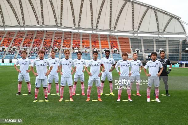 Kagoshima United players line up for the team photos prior to the J.League Meiji Yasuda J3 match between Roasso Kumamoto and Kagoshima United at Egao...