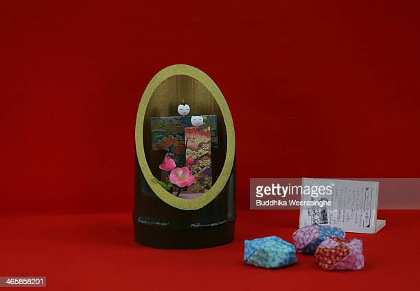 Kaguyabina a pair of paper dolls is placed inside a bamboo container for Hinamatsuri on display after completion at Matsui Kogeisha doll workshop on...