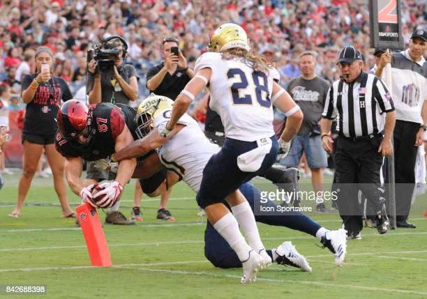 SDSU Kahale Warring dives to score a touchdown during the college football game between UC Davis Aggies and San Diego State University Aztecs on...