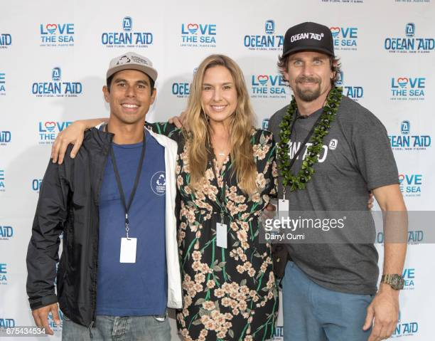 Kahi Paccaro Deborah Bassett and Campbell Farrell pose for a photo before the Ocean Aid Rocks The Park concert at the Waikiki Shell on April 30 2017...