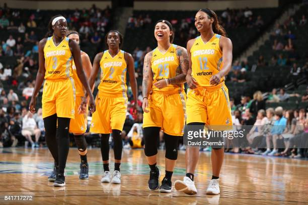 Kahleah Copper Makayla Epps and Bashaara Graves of the Chicago Sky react to a play during the game against the Minnesota Lynx on September 1 2017 at...