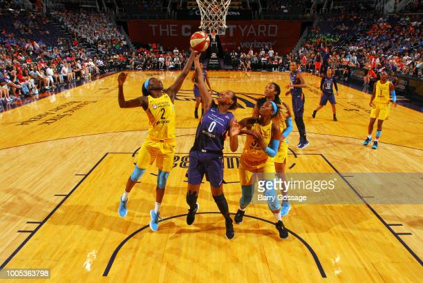 Kahleah Copper of the Chicago Sky and Angel Robinson of the Phoenix Mercury reach for the ball on July 25 2018 at Talking Stick Resort Arena in...