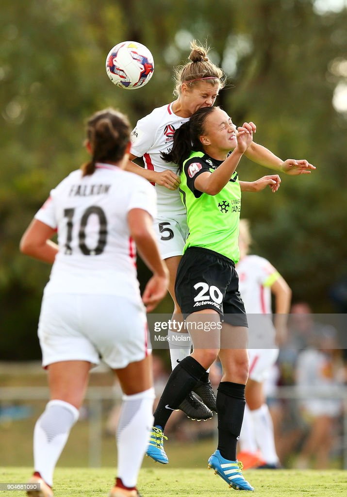 Kahlia Hogg of the Wanderers and Amy Sayer of Canberra contest possession during the round 11 W-League match between Canberra United and the Western Sydney Wanderers at McKellar Park on January 14, 2018 in Canberra, Australia.