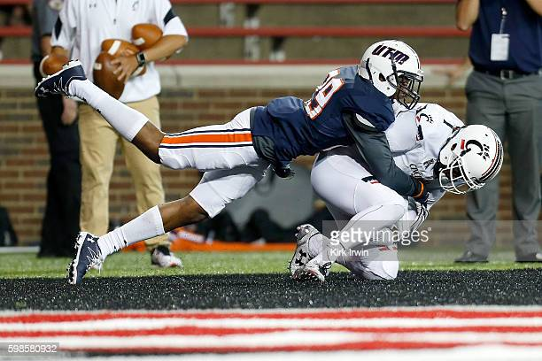 Kahlil Lewis of the Cincinnati Bearcats catches a pass for a touchdown while being defended by Chris Williams-Hall of the Tennessee-Martin Skyhawks...