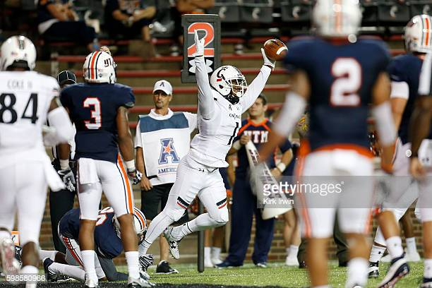 Kahlil Lewis of the Cincinnati Bearcats celebrates after scoring a touchdown during the third quarter of the game against the Tennessee-Martin...