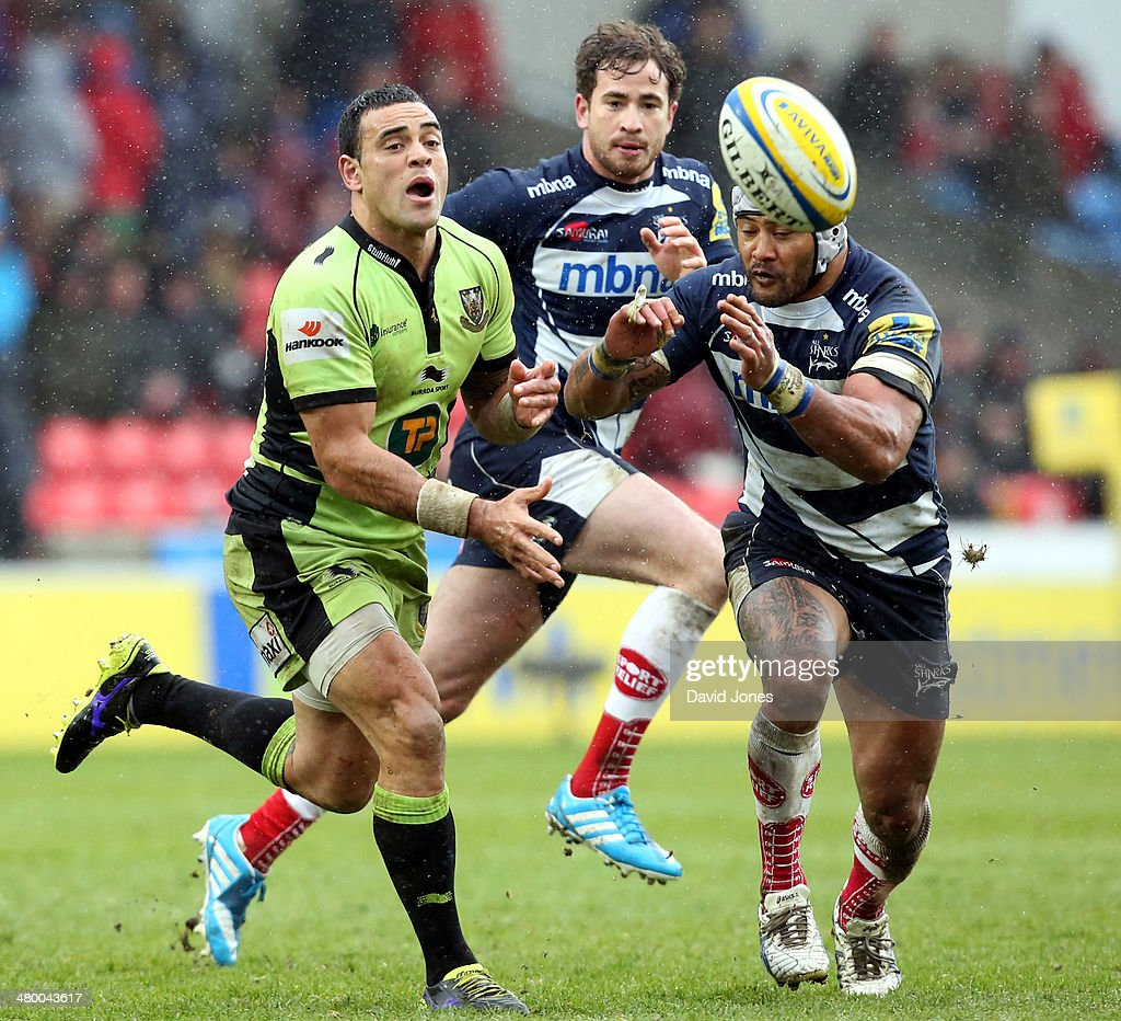 Kahn Fotuali'i of Northampton Saints is challenged by Johnny Leota of Sale Sharks during the Aviva Premiership match between Sale Sharks and Northampton Saints at A J Bell Stadium on March 22, 2014 in Salford, England