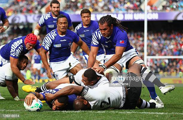 Kahn Fotuali'i of Samoa goes over to score their first try during the IRB 2011 Rugby World Cup Pool D match between Fiji and Samoa at Eden Park on...