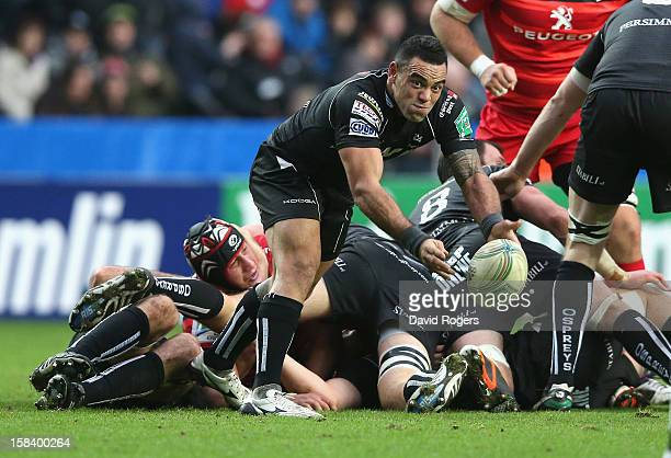 Kahn Fotuali'i of the Ospreys passes the ball during the Heineken Cup match between Ospreys and Stade Toulouse at the Liberty Stadium on December 15...