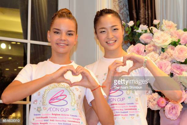 Kaho Minagawa of Japan and Dina Averina of Russia pose for photographs during a press conference ahead of the Rhythmic Gymnastics AEON Cup on...